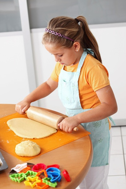 Child baking cookies