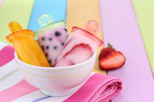 Fruit ice cream in bowl on wooden table close-up