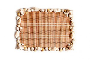 The frame of the wood and seashells on a white background.