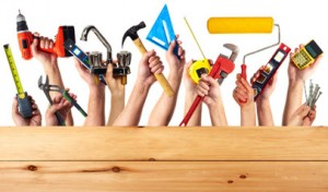 Hands with construction tools.