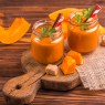 Fresh pumpkin smoothie in glass jar with parsley