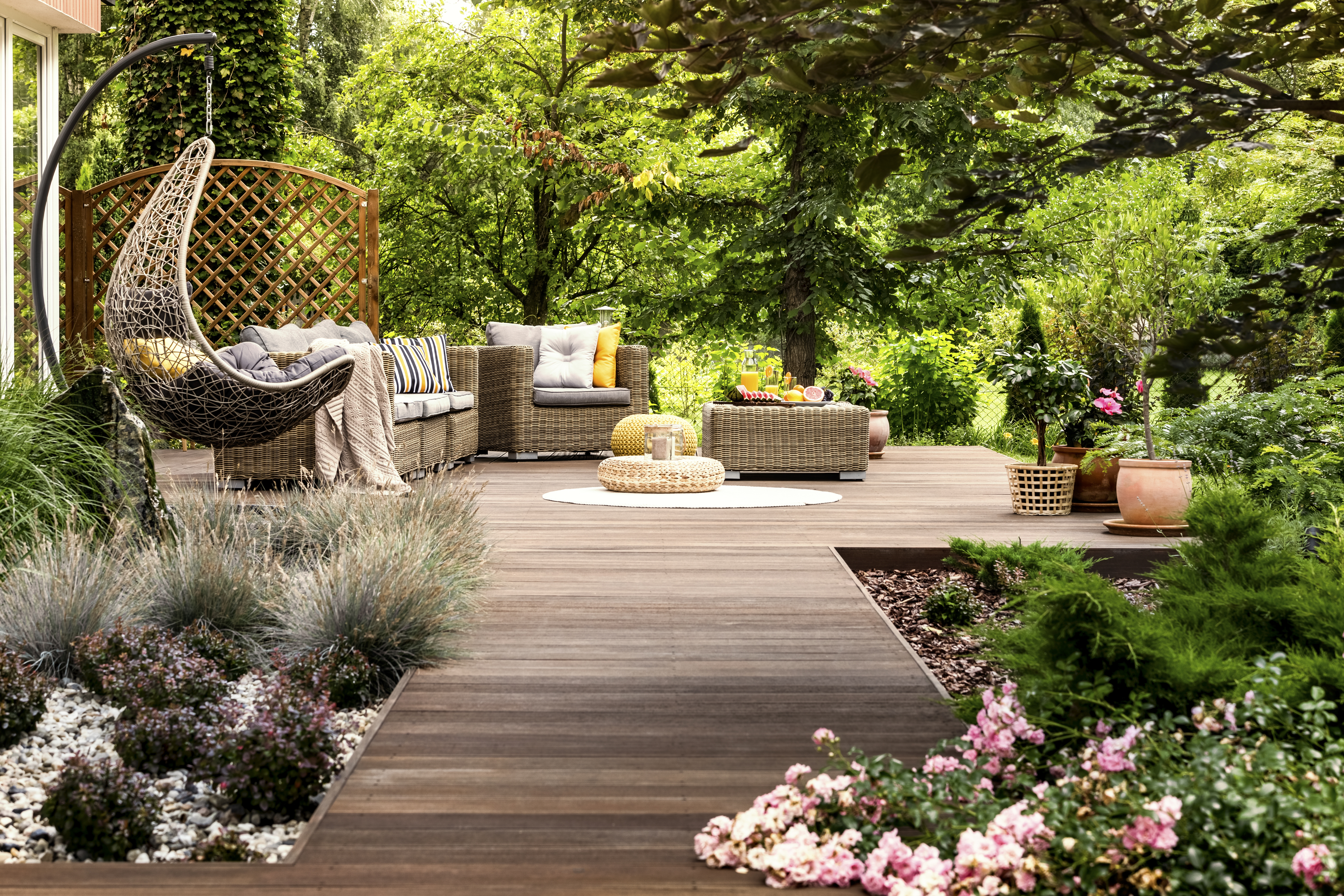 Wooden terrace surrounded by greenery